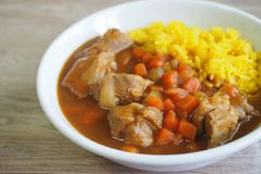 Japanese style pork loin curry with yellow curry rice royalty free stock photos