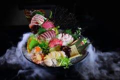 Japanese style raw fish sashimi plate. Japanese style raw fish sashimi on plate with scallop and many raw fishes stock photography