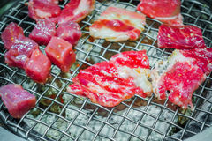 Japanese style Raw fresh beef on hot barbecue grill . Royalty Free Stock Image