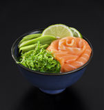 Japanese style seaweed salad with salmon, avocado and lime Royalty Free Stock Image