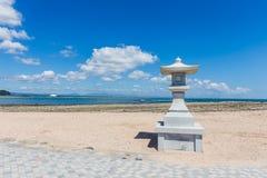 Japanese style stone lamp in white sand beach in Aoshima island,. Miyazaki, Japan Stock Photo