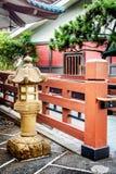 Japanese-style stone lantern and walkway Stock Photography