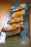 Japanese style sushi fried goose liver Stock Photography