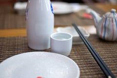Japanese style table set and sake Royalty Free Stock Photos