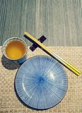 Japanese style tableware. Japanese style chopsticks and plate Stock Photography