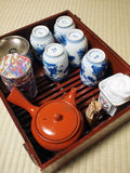 Japanese style tea set. Including cups, teapot, tea cans, towel, toothpicks in a wooden rack Stock Images