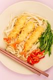 Japanese Style Tempura Prawns With Udon Noodles Chilli and Spring Onions. Against A Lilac Background stock image