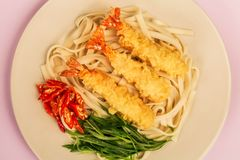Japanese Style Tempura Prawns With Udon Noodles Chilli and Spring Onions. Against A Lilac Background stock photography