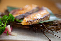 Japanese style teppanyaki roasted cod fish. On palm leaf Stock Image