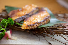 Japanese style teppanyaki roasted cod fish. On palm leaf Royalty Free Stock Photography