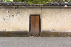 Japanese style wooden door and old wall Stock Photo