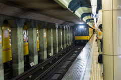 Japanese Subway train is coming in Track with waited passenger Stock Photography