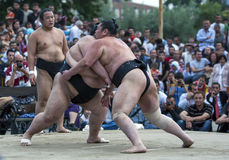 Japanese Sumo Wrestlers at Edirne in Turkey. Japanese Sumo Wrestlers put on a exhibition bout for a curious audience during the Kirkpinar Turkish Oil Wrestling Stock Photography
