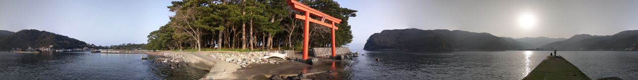 Japanese Sunrise. Shinto shrine gate facing the sea and rising sun Royalty Free Stock Photos