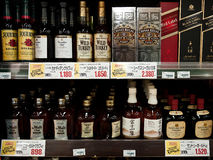 Japanese supermarket goods. Whiskey and wine, and price tags in supermarket, in Nagoya Japan. March 18, 2010 Royalty Free Stock Photos