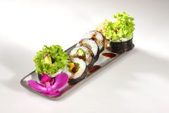 Japanese sushi. With salmon fish on white background Royalty Free Stock Photos