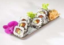 Japanese sushi. With raw fish on white background Stock Photos