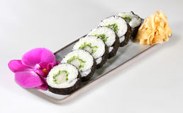 Japanese sushi. With raw fish on white background Royalty Free Stock Photography