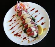 Japanese sushi. Japanese food, sushi served on white plate and black background Royalty Free Stock Image