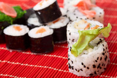 Japanese sushi. On a red bamboo napkin. Series japanese food Royalty Free Stock Photography
