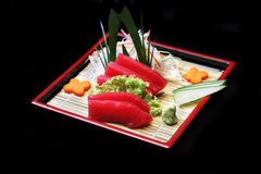 Japanese sushi. Japanese Tuna sushi in bamboo dish on black background Royalty Free Stock Photography