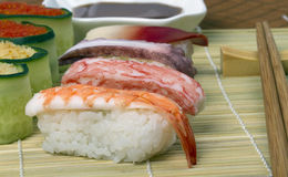 Japanese sushi. Fast snack of crude seafood, rice and vegetables Royalty Free Stock Photo