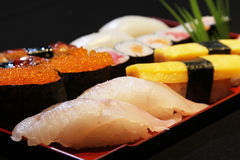 Japanese Sushi. On a wood plate Stock Photos