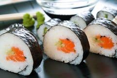 Japanese Sushi. Selection of Japanese sushi arranged on black plate royalty free stock photography