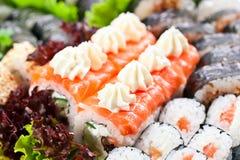 Japanese sushi. Appetizing Japanese sushi with salad leaves Stock Image