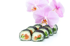Sushi and blooming orchid on a white background. horizontal phot Royalty Free Stock Photos