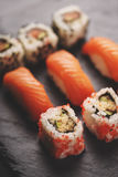 Japanese sushi on black stone plate Stock Images