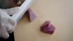 Sushi chef cutting fresh Tuna for sashimi stock video footage