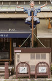 Japanese sushi Chef dummy hanging on a pole. Takayama, Japan - September 24, 2016: Life-size Japanese Sushi chef statue hangs on a pole in front of restaurant Royalty Free Stock Photography