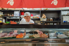 Japanese Sushi Chef. OSAKA, JAPAN - OCTOBER 24: Endo Sushi in Osaka, Japan on October 24, 2014. The restaurant that's akin to Osaka Central Wholesale Market with Stock Photo