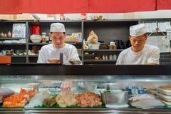 Japanese Sushi Chef. OSAKA, JAPAN - OCTOBER 24: Endo Sushi in Osaka, Japan on October 24, 2014. The restaurant that's akin to Osaka Central Wholesale Market with Royalty Free Stock Photo