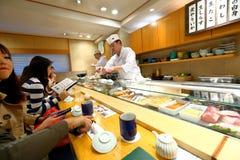 Japanese Sushi Chef. Unidentified Japanese Sushi Chef at Tsukiji market prepares a dish of sushi for his customer Royalty Free Stock Photos