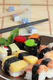 Japanese Sushi with Chopstick on a bamboo mat Stock Photos