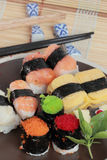 Japanese Sushi with Chopstick on a bamboo mat Stock Images