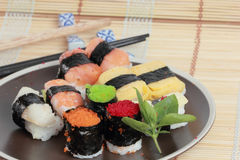 Japanese Sushi with Chopstick on a bamboo mat Royalty Free Stock Photos