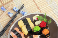 Japanese Sushi with Chopstick on a bamboo mat Stock Image