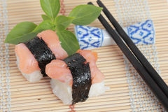 Japanese Sushi with Chopstick on a bamboo mat Royalty Free Stock Images