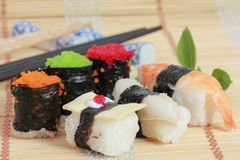 Japanese Sushi with Chopstick on a bamboo mat Stock Photography