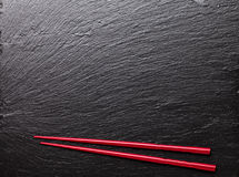 Japanese sushi chopsticks. On black stone background. Top view with copy space Stock Image