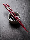 Japanese sushi chopsticks over soy sauce bowl Stock Image