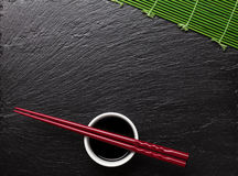 Japanese sushi chopsticks over soy sauce bowl Royalty Free Stock Photos