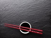 Japanese sushi chopsticks over soy sauce bowl Stock Image