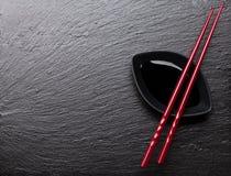 Japanese sushi chopsticks over soy sauce bowl Stock Photo