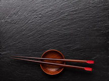 Japanese sushi chopsticks over soy sauce bowl Royalty Free Stock Image