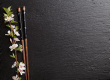 Japanese sushi chopsticks and sakura blossom Stock Photography