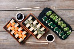 Japanese sushi with chopsticks and sauce bowls Royalty Free Stock Images